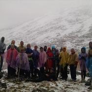 Trekkers wearing ponchos on day 2